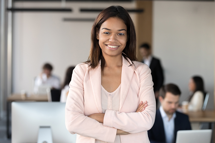 Business Insurance - Portrait of a Smiling Woman in the Office with the Background Blurred