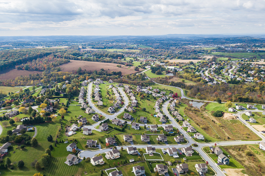 Contact - Aerial View of Rural Town and Surrounding Neighborhood in Pennsylvania During Fall